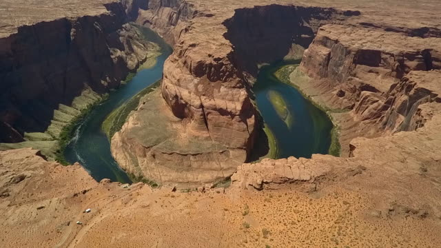 aerial: lake at the bottom of a canyon - canyon lake stock videos & royalty-free footage