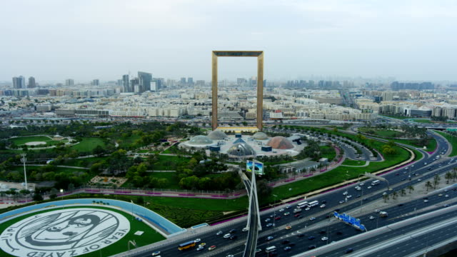 aerial landmark view dubai frame zabeel park uae - global economy stock videos & royalty-free footage