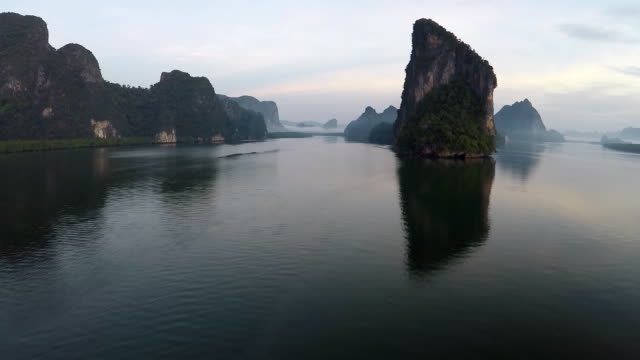 aerial landscape view koh panyee village and ao phang nga national park - karst formation stock videos & royalty-free footage
