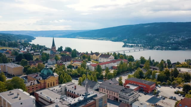 aerial / landscape with mountains, river and buildings in lillehammer town, norway. - town stock videos & royalty-free footage