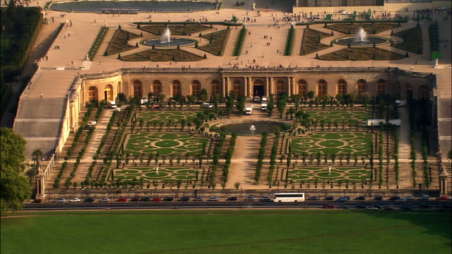 aerial ws landscaped le notre gardens outside chateau de versailles / versailles, ile-de-france, france - chateau de versailles stock videos and b-roll footage