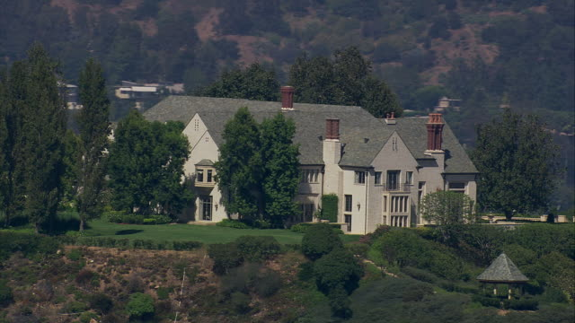 aerial ts la cu  large mansion, bel air, california, united states - stately home stock videos & royalty-free footage