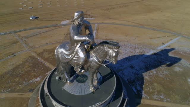 aerial: large statue of genghis kahn on the roof of a museum - ulaanbaatar, mongolia - ulan bator stock videos & royalty-free footage