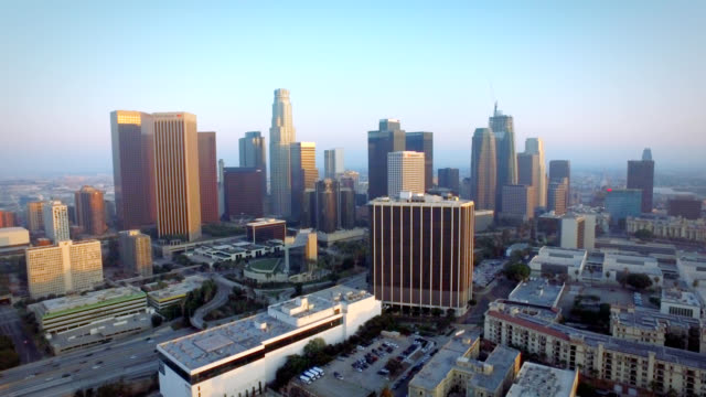 aerial left to right pan of downtown los angeles california at sunset - staples centre stock videos & royalty-free footage