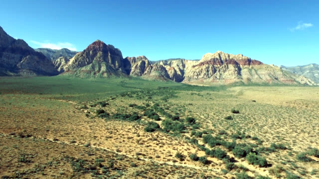 Aerial left to right track of red rock canyon in Nevada.