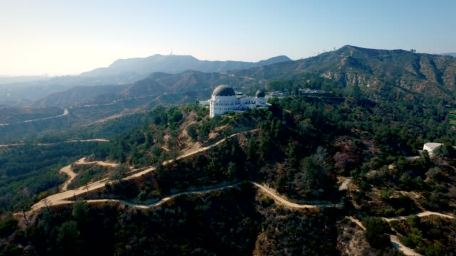Aerial left to right tracking shot around the Griffith Observatory in Hollywood California.