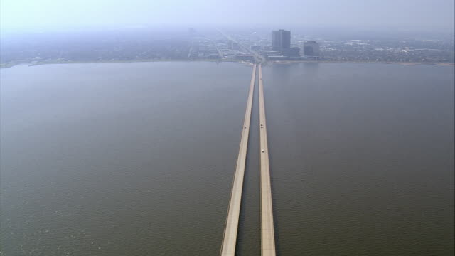 Aerial light traffic across causeway over Lake Pontchartrain to city/ New Orleans Louisiana