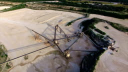 Aerial Limestone Extraction Open Pit Mine Sunset Near Conveyor Belt  Triangles Stock Footage Video