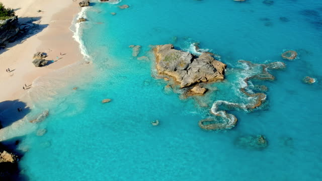 aerial lockdown: amazing shorelines of bermuda with rock formations in spanish point, bermuda - weathered stock videos and b-roll footage