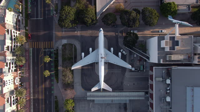 aerial lockdown of a dc-8 airplane on display at the alexander science center school next to quiet city streets - los angeles, california - stationary stock videos & royalty-free footage