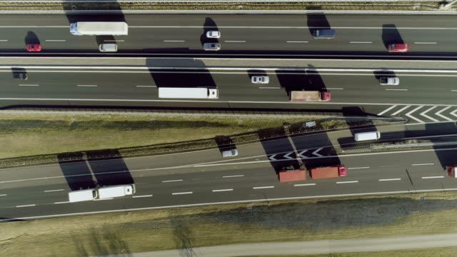 Aerial lockdown shot of vehicles moving on highway junction, Baden-Wuerttemberg, Germany