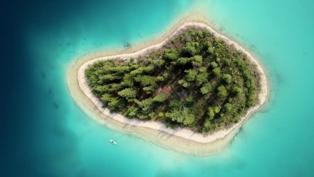 aerial lockdown: small island explored by man on a kayak - small stock videos & royalty-free footage