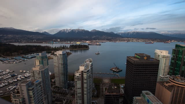aerial lockdown time lapse scenic view of city by sea - vancouver, canada - ferry stock videos & royalty-free footage