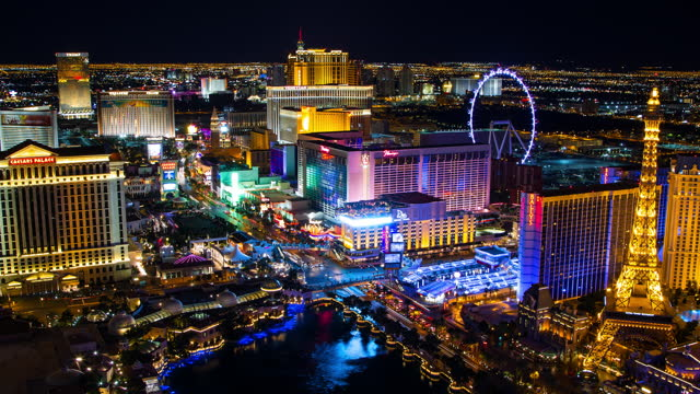 aerial lockdown time lapse shot of illuminated city during night against clear sky - las vegas, nevada - fast motion stock videos & royalty-free footage