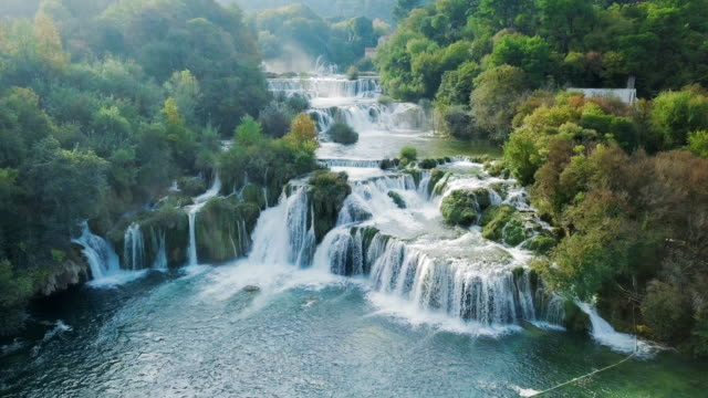 aerial lockdown: waterfalls of kirka national park with free flowing water - croazia video stock e b–roll