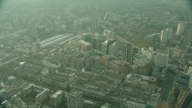 aerial london, england; moves in close over rooftops of buildings - twilight stock videos & royalty-free footage