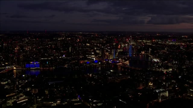 aerial london landmarks lit up blue to thank the nhs and all key workers during the clap for carers event during the coronavirus crisis - wembley stock videos & royalty-free footage