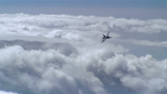 aerial long shot f/a-18 super hornet soaring over clouds / turning / california - us navy stock videos & royalty-free footage
