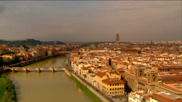 aerial long shot florence cityscape with view of santa maria del fiore / medium shot over arno and ponte vecchio / italy - florence italy stock videos & royalty-free footage