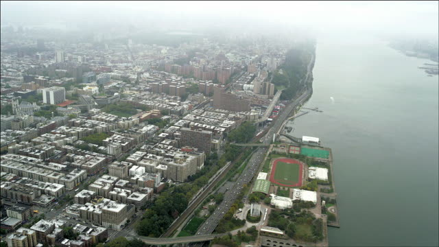 Aerial lookding down and south at Henry Hudson Parkway and Harlem, Manhattan Island, New York.