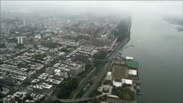 aerial lookding down and south at henry hudson parkway and harlem, manhattan island, new york. - hamilton new york state stock videos & royalty-free footage