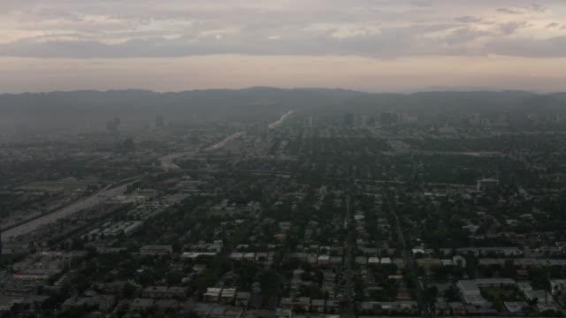 Aerial looking at Century City, Interstate 405, Los Angeles, CA sunrise