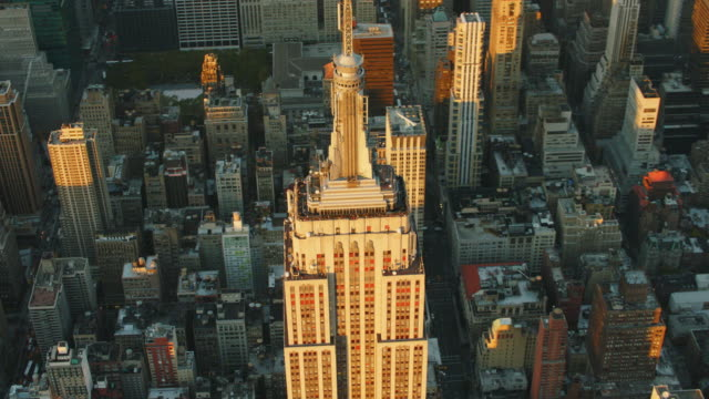 aerial looking at top of empire state building looking down at streets below - empire state building stock videos & royalty-free footage