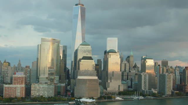 Aerial looking at World Trade Center, Battery Park and west side of lower Manhattan at end of day