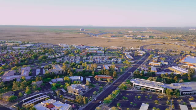 aerial: looking beyond the homes in scottsdale - arizona stock videos & royalty-free footage