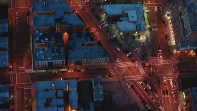 aerial looking directly down a building and streets in harlem at night, nyc - harlem stock videos & royalty-free footage