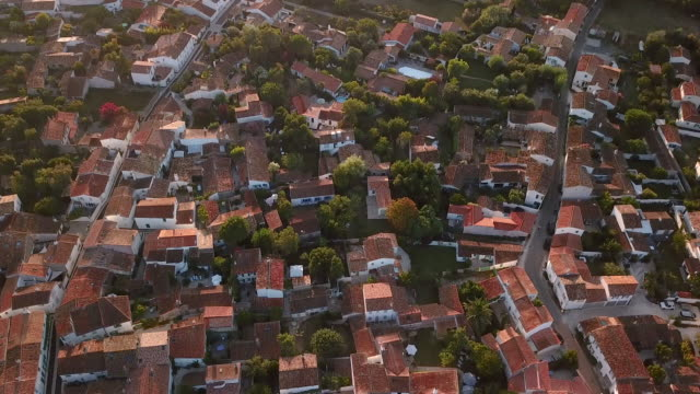 aerial looking directly down at houses and street of the town les portes-en-ré in france - 50 seconds or greater stock videos & royalty-free footage