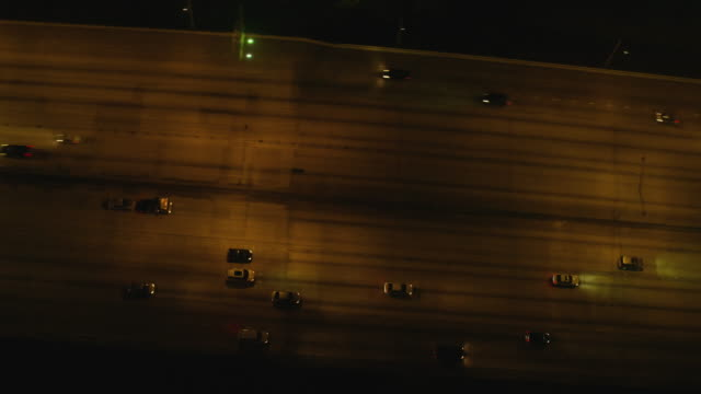 aerial looking directly down on expressway 95 downtown miami at night - american interstate stock videos & royalty-free footage