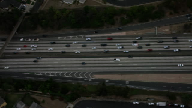 aerial looking directly down on interstate freeway 10 commuter traffic los angeles, ca - interstate 10 stock videos & royalty-free footage
