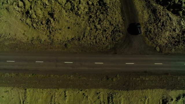 aerial looking directly down on road in iceland - empty road stock videos and b-roll footage