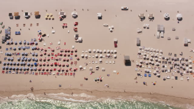 aerial looking directly down on south beach, miami fl - florida usa stock videos and b-roll footage