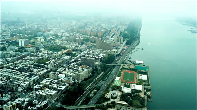 aerial looking down and south at henry hudson parkway and harlem, manhattan island, new york. - hamilton new york state stock videos & royalty-free footage