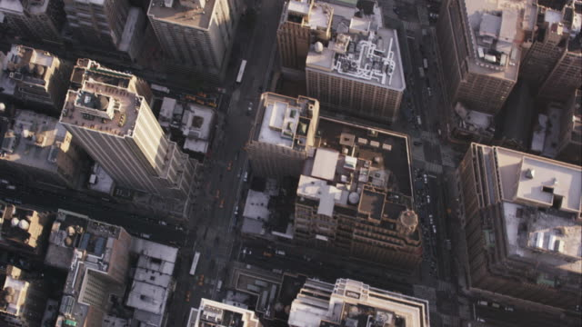 Aerial looking down at buildings flying south over Empire Sate Building, NYC
