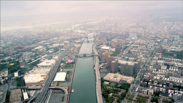 Aerial looking down on Harlem River, Upper Manhattan, New York. Foggy Day.