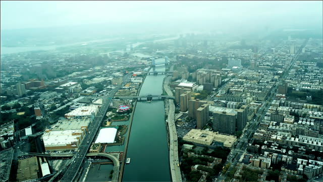 aerial looking down on harlem river, upper manhattan, new york. foggy day. - hamilton new york state stock videos & royalty-free footage