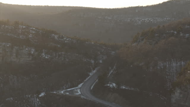 aerial looking down on road through the mountains - new paltz stock videos and b-roll footage