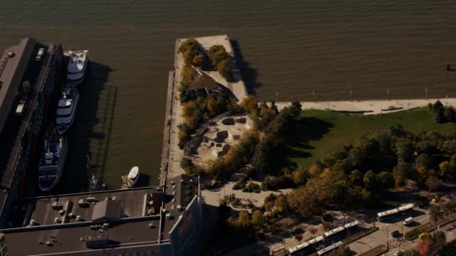 aerial looking down on skateboard park, west side highway, nyc - chelsea piers stock videos & royalty-free footage