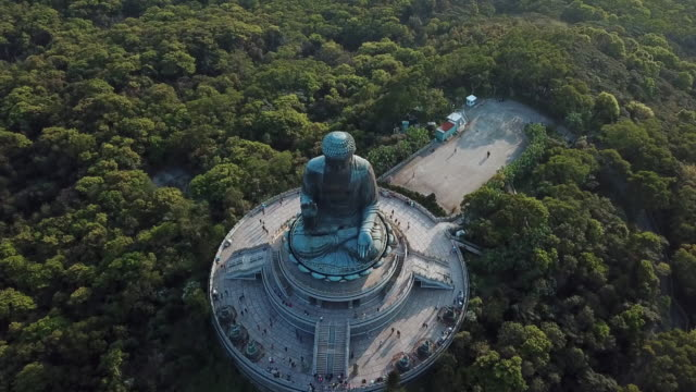 aerial: looking down onto tian tan buddha and the tourists sightseeing - tian tan buddha stock videos and b-roll footage