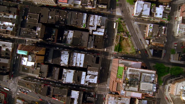 aerial looking down over manhattan streets / moving south from canal street / new york city - establishing shot stock-videos und b-roll-filmmaterial