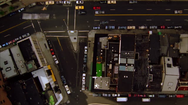 aerial looking down over manhattan streets / zoom in white limousine standing in traffic / new york city - 1993 stock videos & royalty-free footage