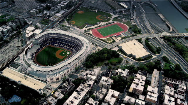 Aerial looking down Yankee Baseball Stadium, Upper Manhattan, New York. Foggy Day.