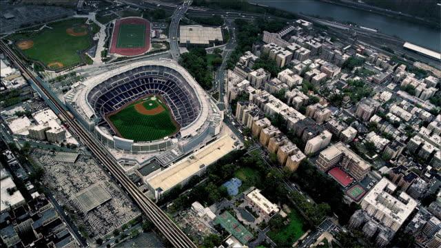aerial looking down yankee baseball stadium, upper manhattan, new york. foggy day. - new york stato video stock e b–roll