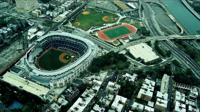 aerial looking down yankee baseball stadium, upper manhattan, new york. foggy day. - hamilton new york state stock videos & royalty-free footage