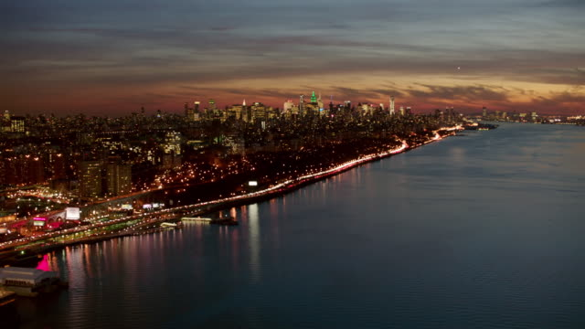 aerial looking south over hudson river with manhattan in the distance with approach close to west side highway, nyc - hd format stock-videos und b-roll-filmmaterial