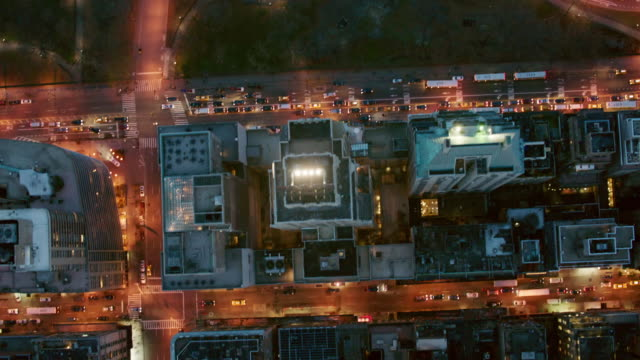 aerial looking straight down at upper manhattan going into central park at night, nyc - straight stock videos and b-roll footage