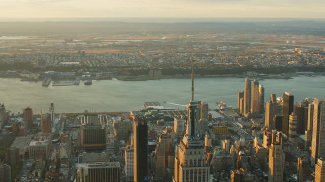 Aerial looking west at top of Empire State building with west side of Manhattan and New Jersey behind